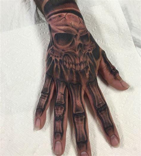 pin skull hand tattoos