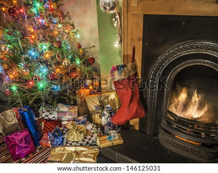 cosy fireside with Christmas tree, decorations, stocking and