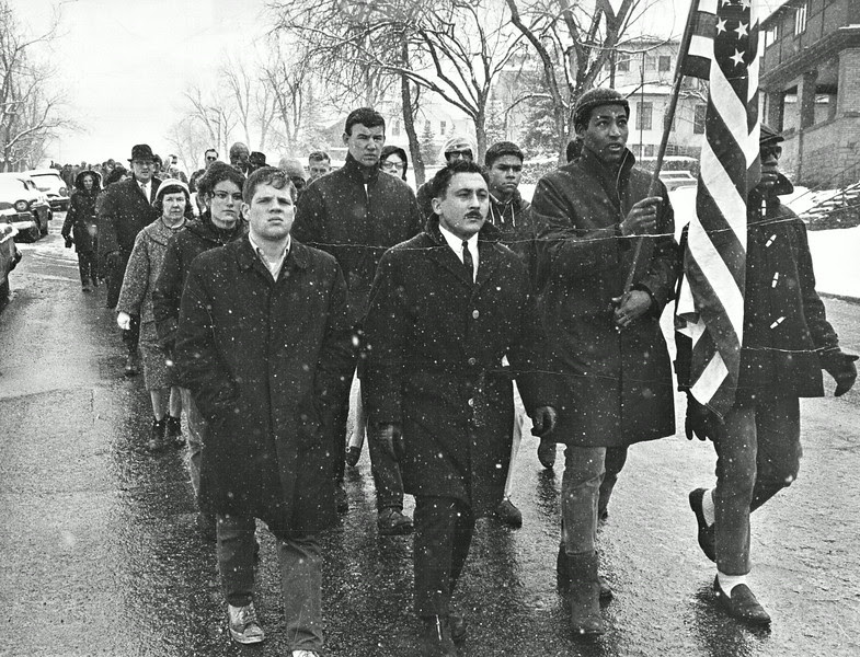 Description of  MAR 9 1965 - 100 Men and Women take part in Boulder Sympathy March. The grim-faced marchers moved from the University of Colorado campus to downtown Boulder in support of Alabama civil rights workers. There were no incidents during march. (Ed Maker /The Denver Post)