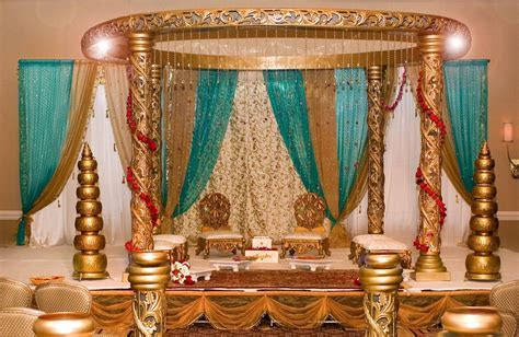 gold turquoise and pearls golden carved mandap in a formal