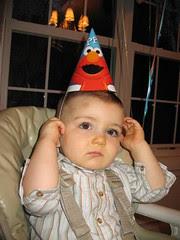 Brennan in a birthday hat.