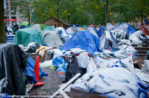 Protests: Occupy Wall Street demonstrators' tents in Zuccotti Park, New York City, were covered with snow