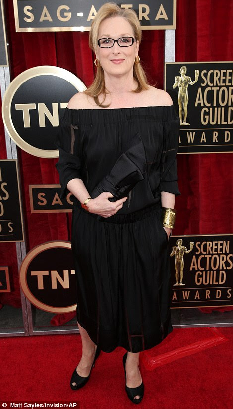 Always stylish: Claire Danes (left) wore an unusual layered cream and black frock with dark blue metallic detail and a sheer black overlay, while Meryl Streep went for a much more simplistic look in her black off-the-shoulder tea-length frock and matching black accessories