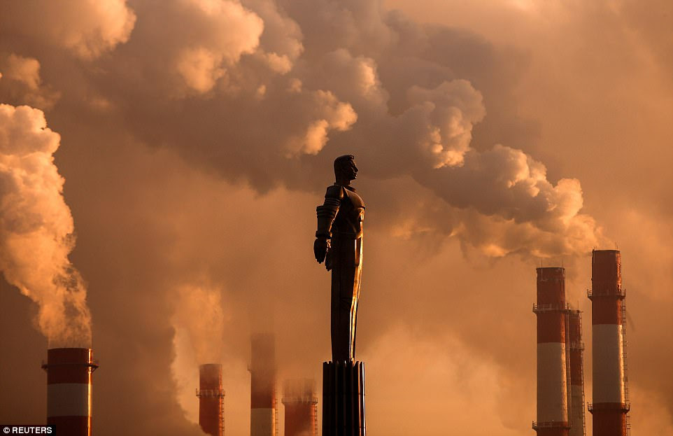 A monument of Soviet cosmonaut Yuri Gagarin - the first man to travel to space - appears against a backdrop of steam rising from a heating power plant's chimneys at sunset in Moscow, where the air temperature was about -17 degrees Celcius on January 9