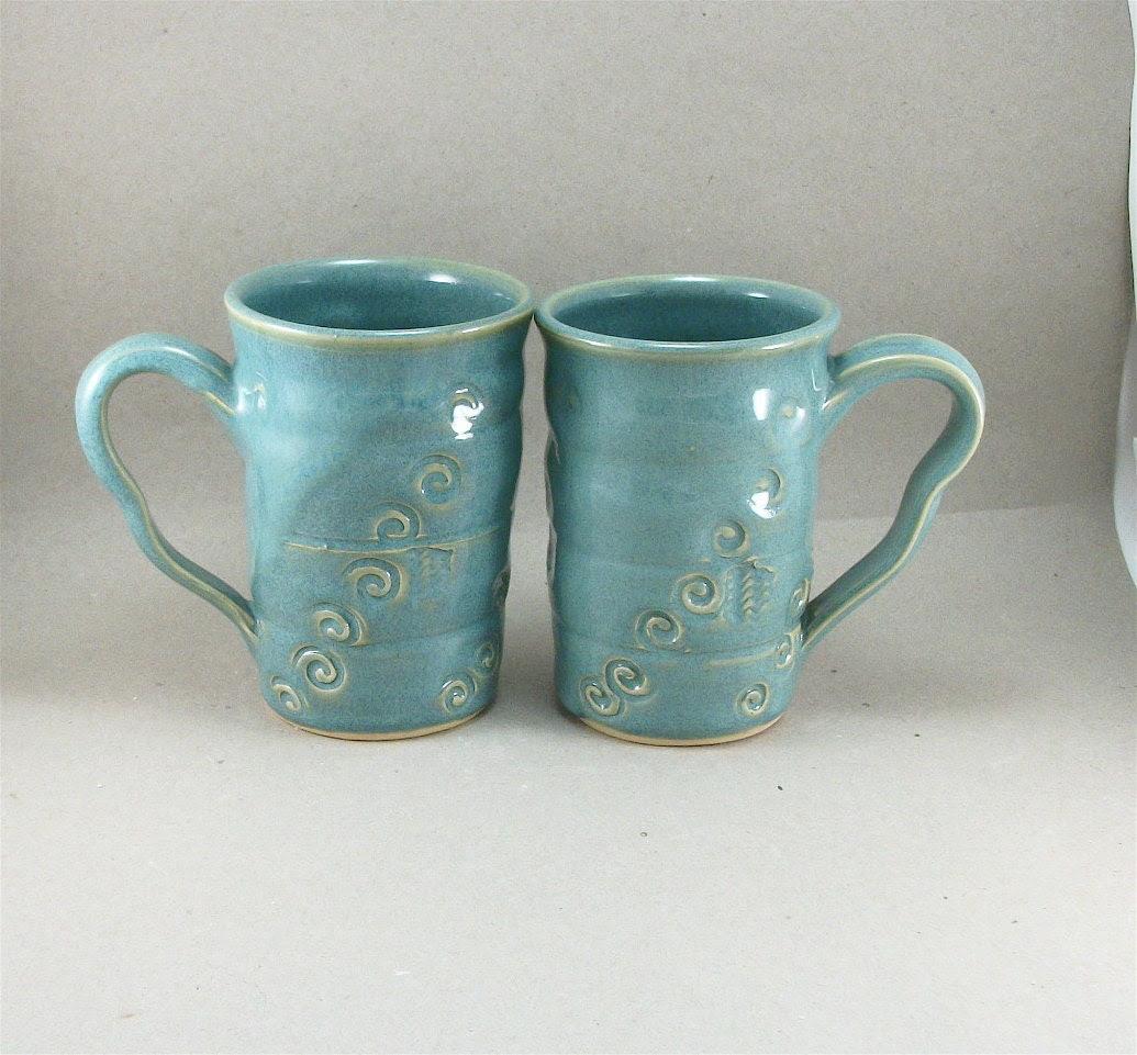 pair of turquoise mugs