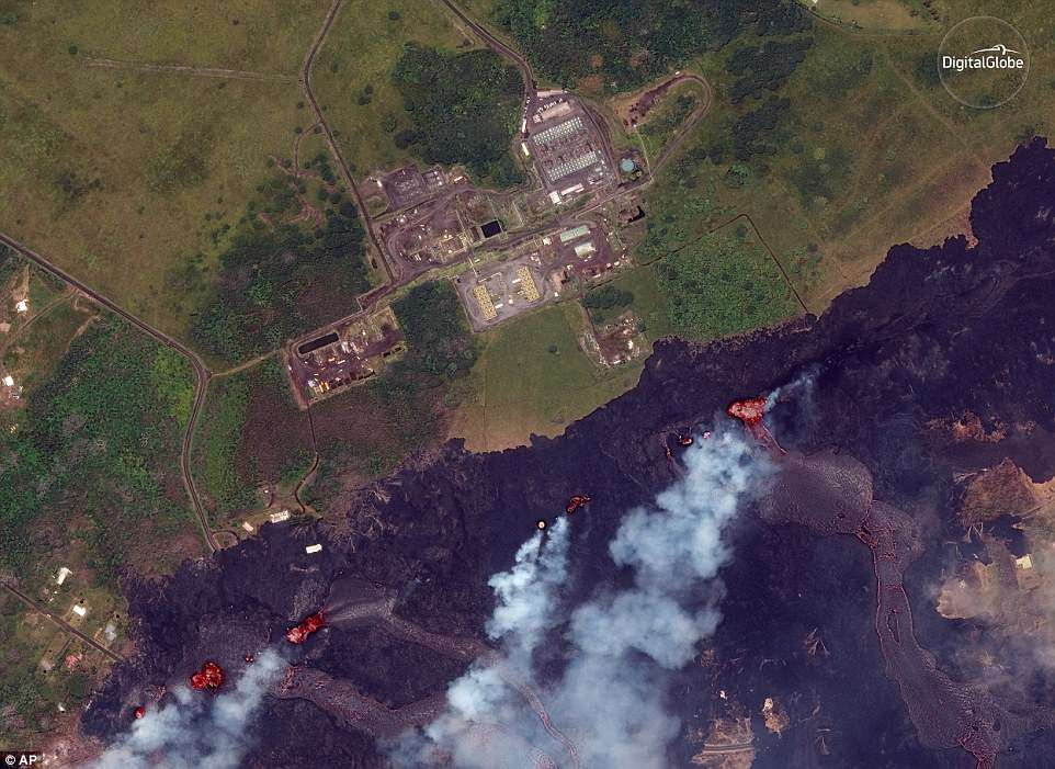 This satellite photo shows lava coming out of fissures caused by Kilauea volcano, near the Puna Geothermal Venture, a geothermal energy plant, in Pahoa, Hawaii