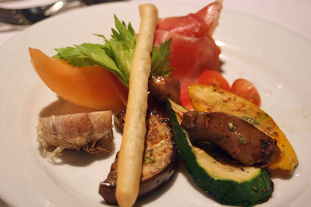Antipasti of cured Italian ham, seasonal melon, grilled vegetables, marinated portabello moshrooms and baked caramelized garlic