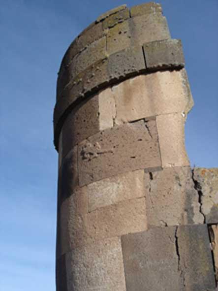 A Chulpa tower at Sillustani with Lizard relief, Peru.