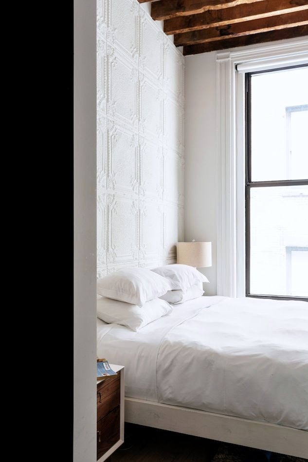 Le Fashion Blog A Fashionable Home Neutral Chic Bedroom New York City Textured Wall Crisp White Linens Exposed Beams Via One Fine Stay
