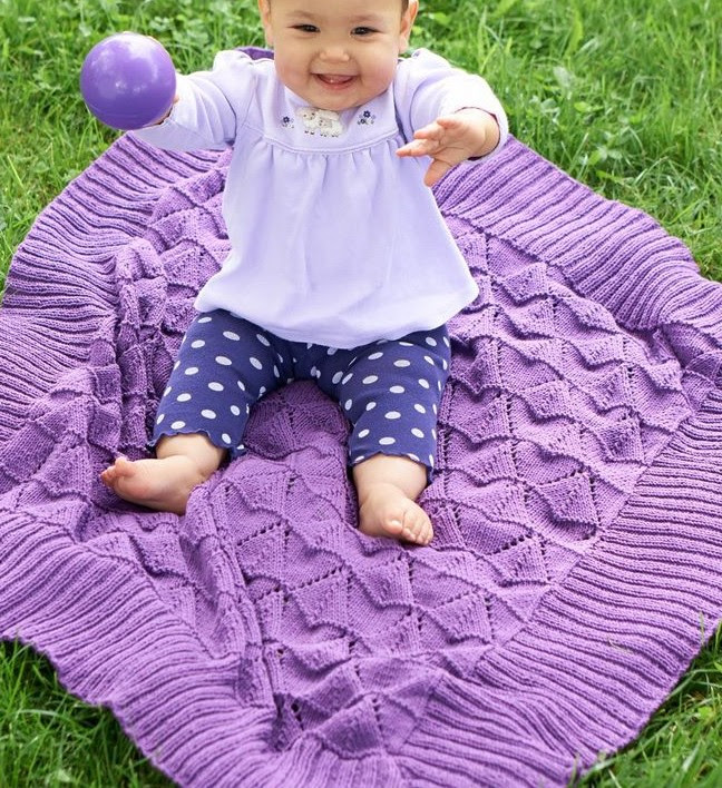 Free knitting pattern for Light and Lovie Baby Blanket with triangle lace pattern and more baby blanket knitting patterns