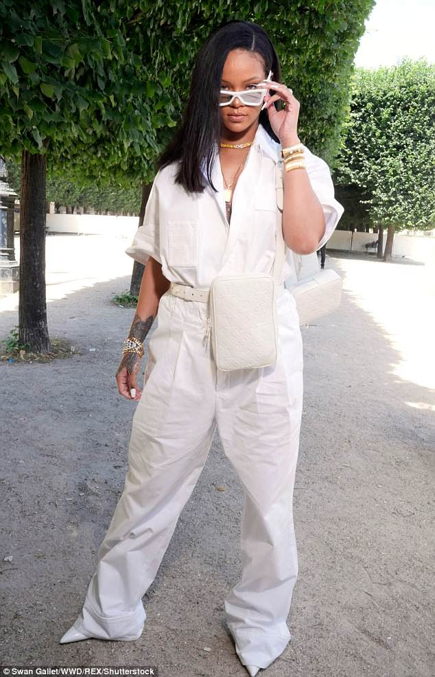 Work it: Rihanna continued to turn heads as she arrived to the Louis Vuitton Menswear SS19 in Paris on Thursday, clad in a white boiler suit