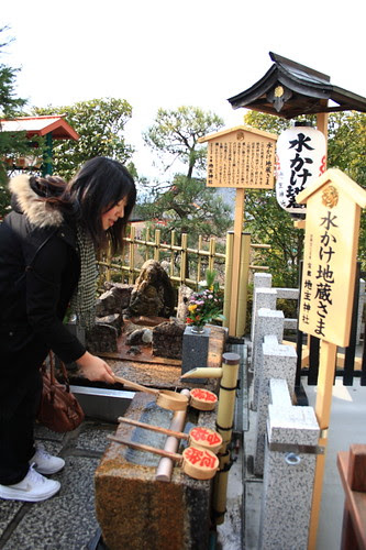 Japanese gals wishing for love luck in Kiyomizu temple