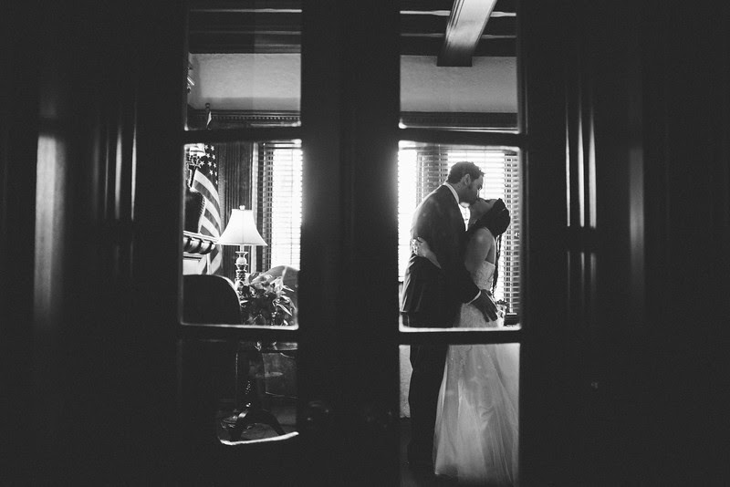 Portraits with the bride and groom indoors and outdoors of the University Club in downtown Rockford IL on a beautiful spring day.