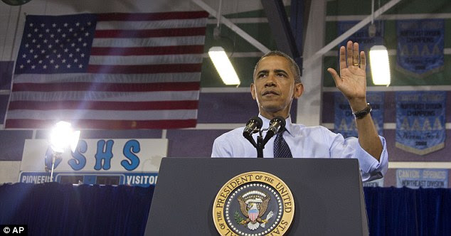 Easy does it: President Obama gestures as he is interrupted by a protester as he speaks at a campaign event at Canyon Springs High School in Nevada earlier this week