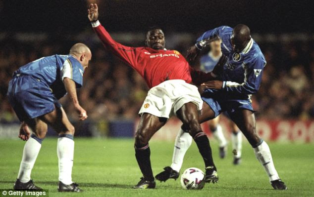 Unaware Andy: Manchester United player Andy Cole was too busy battling for the ball with Chelsea's Frank Leboeuf and Bernard Lambourde in the FA Cup quarter-final replay to look up and see a UFO