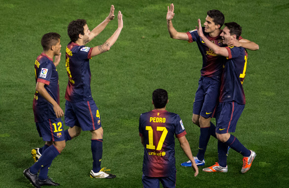 Lionel Messi celebrates with his Barcelona teammates after scoring his 300th career goal on Saturday. (Getty Images)