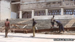 Workers rebuilding the Somali National Theatre