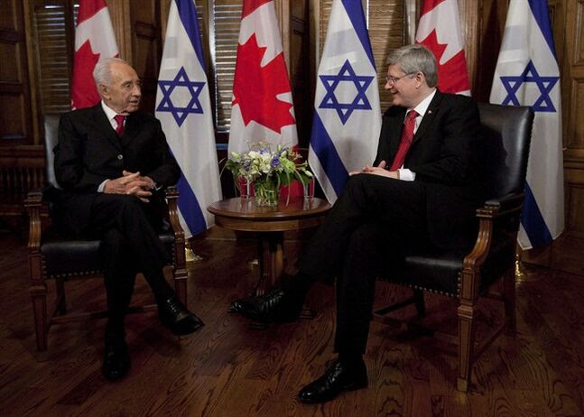 Israel President Shimon Peres talks with Canadian Canadian Prime Minister Stephen Harper before a meeting on Parliament Hill in Ottawa, Monday May 7, 2012. Harper will make history in Israel next week when he becomes the first Canadian leader to address the Israeli legislature. THE CANADIAN PRESS/Adrian Wyld