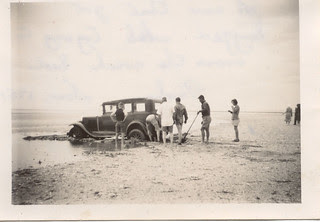 A car is bogged at Port Parham South Australia in 1951