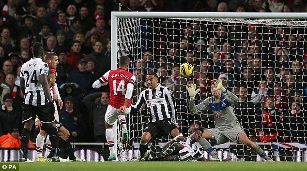 Composed: Walcott's second was another clever finish under pressure from the men in black and white