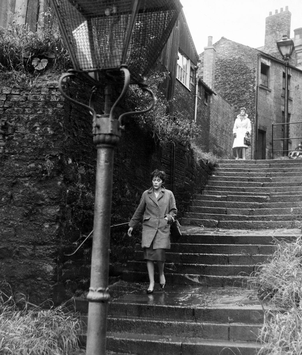 Scenes from the British film Payroll. A crime thriller starring Michael Craig and Franoise Prvost. Directed by Sidney Hayers. Billie Whitelaw trailing Francois Prevost, on the Long Stairs, Newcastle. Circa 1961