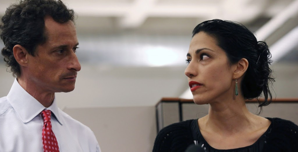 New York mayoral candidate Anthony Weiner and wife Huma Abedin at a news conference in New York City at which Weiner acknowledged that he engaged in lewd online conversations with a woman after his resignation from Congress, July 23, 2013. (Photo by John Moore/Getty Images)