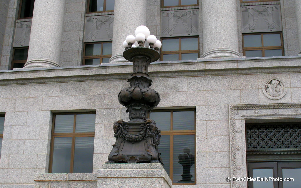 Across from the Minnesota State Capital building are several State buildings. As I was walking past the front doors, I noticed these elaborate lamps.