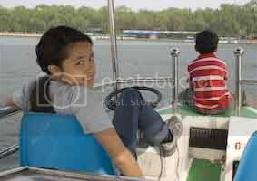 Kids driving our electric boat at Be Hai Park