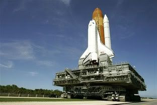 NASA returns Atlantis to the launch pad on August 29 after it is determined that Tropical Storm Ernesto will not pose a danger to the space shuttle.