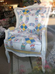 "Quilt upholstered vintage chair.  Seen in the window of a Michigan Shop ""Patricia Wood & Company"" Harbor Springs, Michigan"
