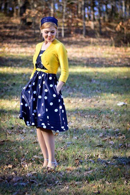Modest polka dot dress in navy blue with yellow sweater.