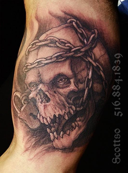 Grey Ink Skull And Chain Tattoo On Muscles