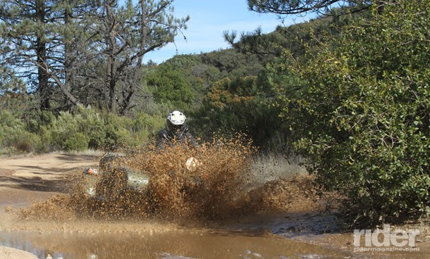 Mud puddles are no problem for the 2WD Ural. In fact, they're pretty fun—as long as you're wearing waterproof gear!