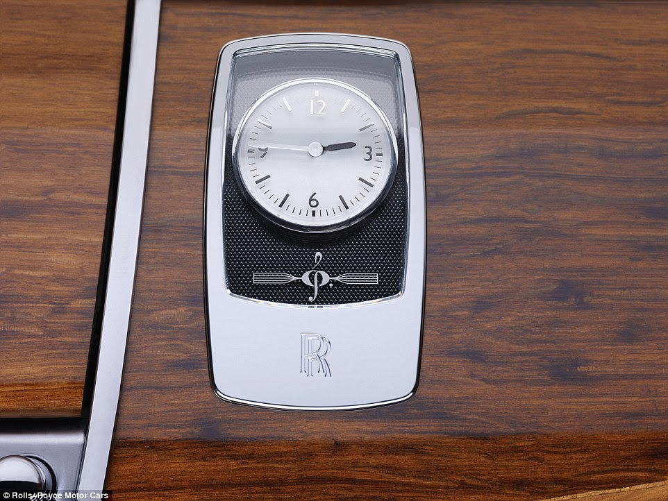 The clef symbol appears throughout the design, with it etched on the interior clock panel and painted onto the doors on the outside of the cars