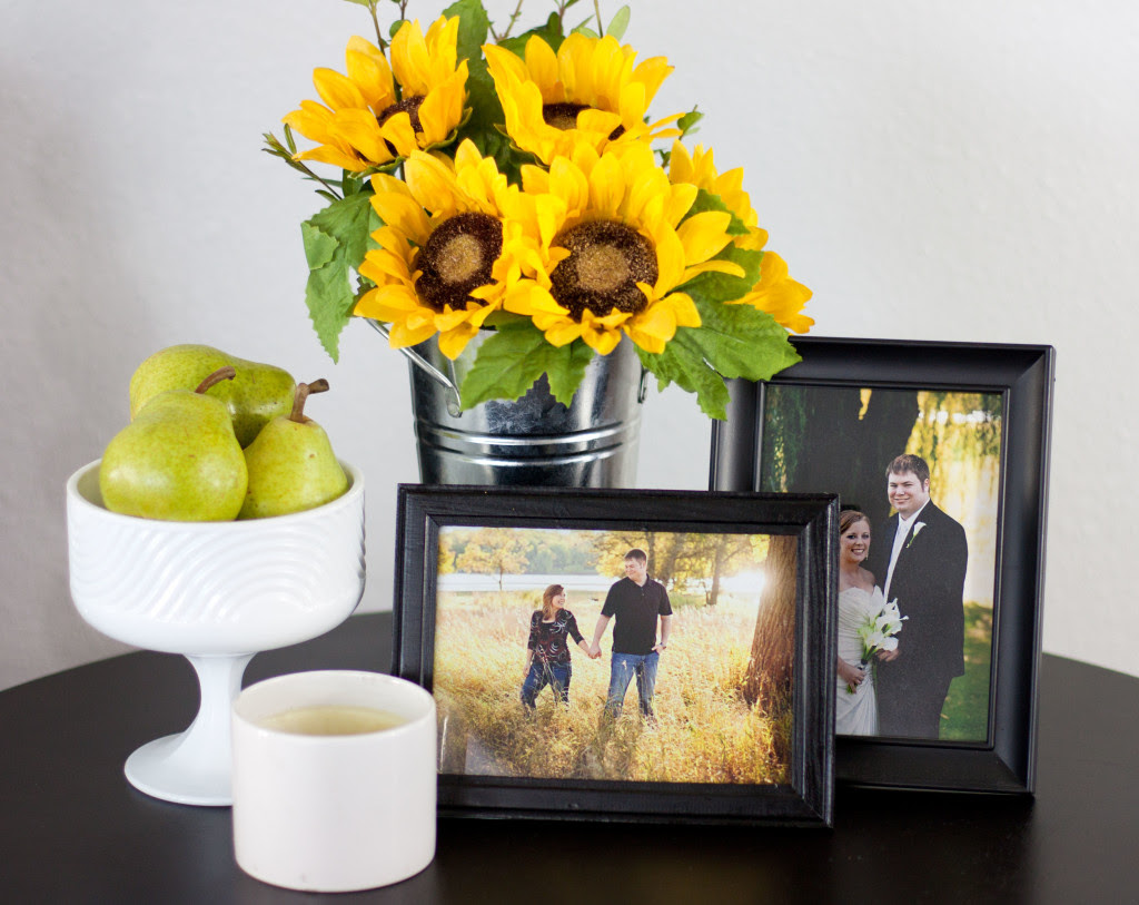 What a beautiful summertime vignette! Decorating with pears and sunflowers is such a pretty idea.