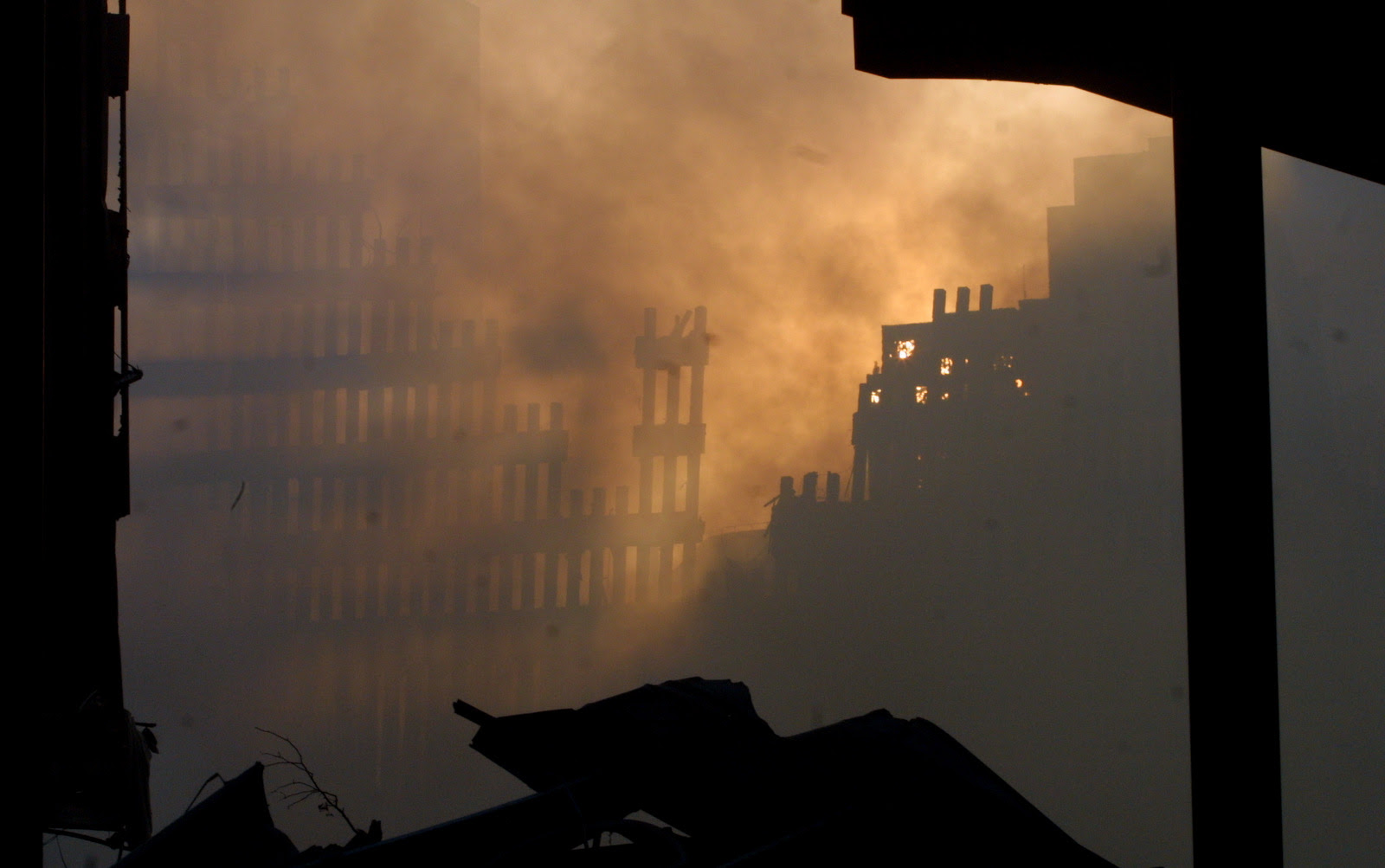 Light is seen through the debris at ground zero on September 12, 2001 after the September 11 terrorist attacks.(AP/Baldwin)