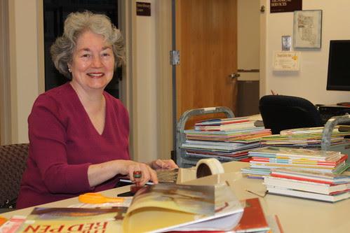 senior library volunteer on desk in public library; Library Snapshot Day 4031, Chelmsford Public Library, Flickr