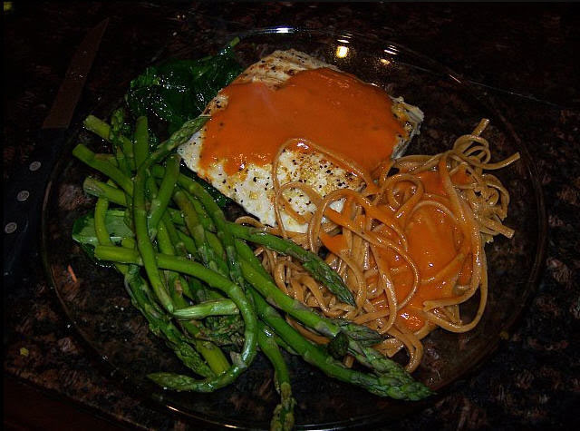 Healthy Eats! Grilled Mahi Mahi, Asparagus, and Whole Grain Pasta with Roasted Red Pepper and Tomato Sauce.