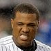 Wet weather affected Robinson Cano when he batted in the third inning at Yankee Stadium.