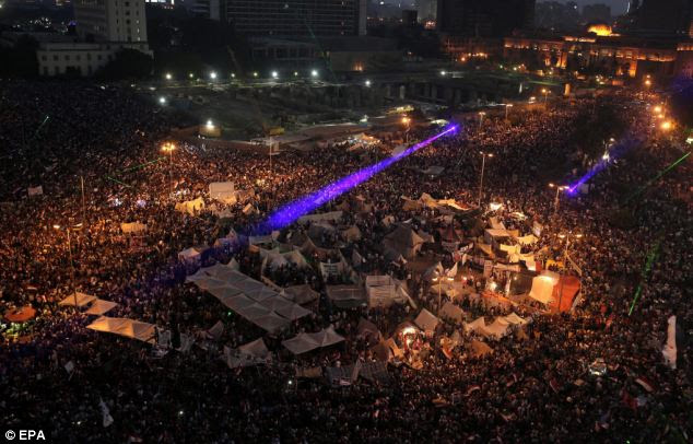 Celebrations broke out after the head of Egypt's armed forces issued a declaration suspending the constitution