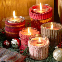 Five candles with sweater holders