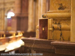 The 1861 Lincoln Inaugural Bible against the backdrop of the Main Reading Room of the Library of Congress.