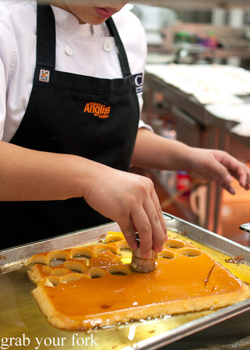 Cutting out discs of flan at the Filipino Barbie