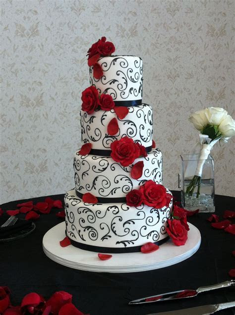 Elegant red, black and white wedding cake. Event and photo