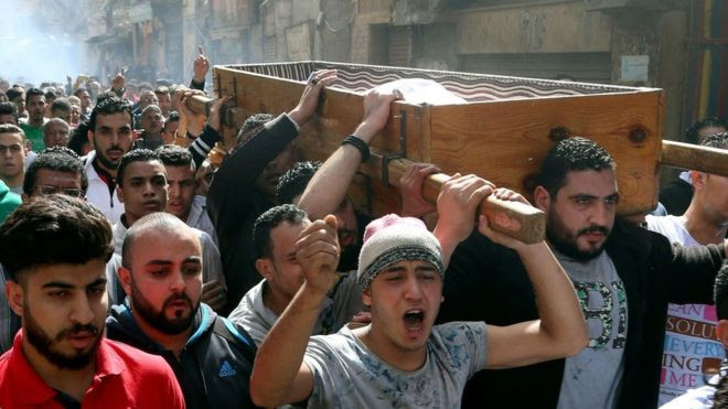 Egyptian mourners carry the coffin of Mohamed Ali Sayed Ismail, who was allegedly shot dead by a policeman over a fare dispute the day before, during his funeral on February 19, 2016