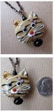 multiple photos of cat necklace
