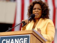 COLUMBIA, SC - DECEMBER 9: Talk show host Oprah Winfrey introduces Democratic presidential hopeful Sen. Barack Obama (D-IL) to a crowd of 29,000 during a campaign event at the William Bryce Football Stadium on December 9, 2007 in Columbia, South Carolina. Obama and Winfrey are scheduled to make one more stop in New Hampshire today. (Photo by Stephen Morton/Getty Images)