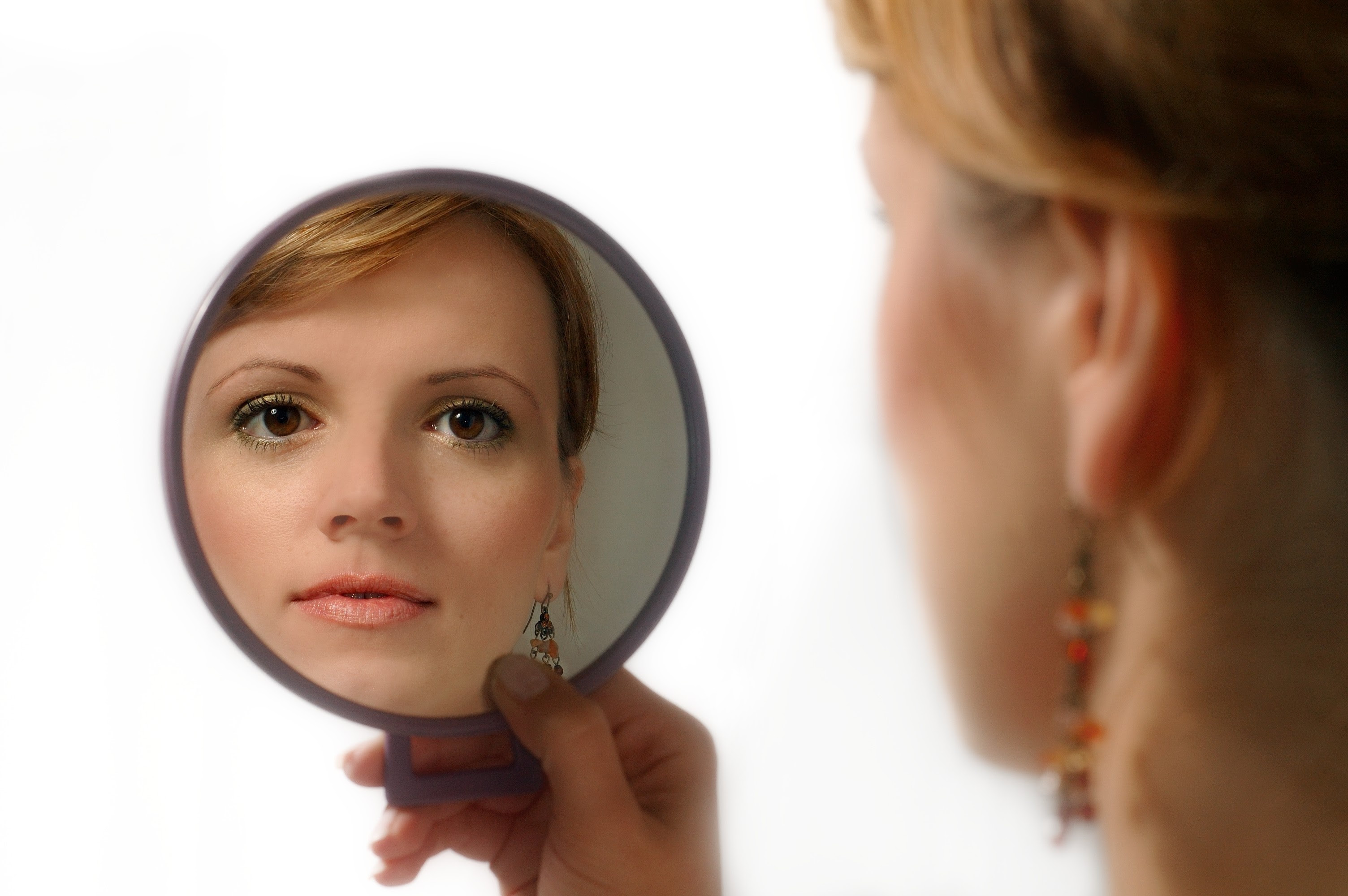 Image result for woman looking in mirror