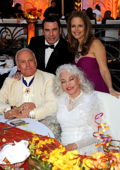 (Top Row) Actor John Travolta, wife actress Kelly Preston, (Bottom Row) astronaut Buzz Aldrin and wife Lois Driggs Cannon attend The Church of Scientology Celebrity Centre 41st Anniversary Gala held at the Church of Scientology Celebrity Centre on August 7, 2010 in Los Angeles, California.