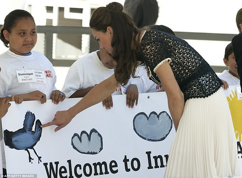 Royal snail  Kate races ahead with her painting at Inner-City Arts  campus whilst William is slow off the mark  3